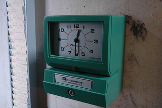 Factory punch clock at Fabre's art laboratory. Photographed by Bernard Polet.  Via Flickr.