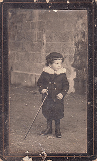 """Portrait of a young boy holding a walking stick/cane (undated)"" from pellethepoet. Via Flickr. I searched Flickr for ""fashion walking stick"" and this was the second result. Hahahahahaaaa"