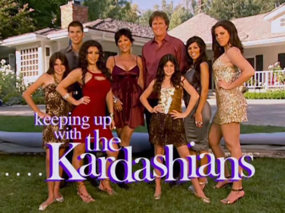 Keeping Up With the Kardashians  season 1 (2007) title card. The Kardashian clan stands assembled on their front lawn, in front of a large house. They look fairly normal and relatable, though they are clearly rich. Source:  The Sun . The image exudes a sense of family togetherness, as the whole blended family have gathered together and using their best camera poses. They seem nice, if a bit awkward and even dweeby. This is in stark contrast with later seasons' marketing imagery, which oozes unattainable yet deeply seductive power glam. See, e.g. season 14's (2017-18) branding  here .