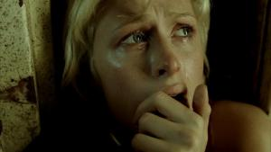 Still from horror movie  House of Wax  (2005; dir. Jaume Collet-Serra), showing Paris Hilton (playing the role of Paige Edwards) crying.