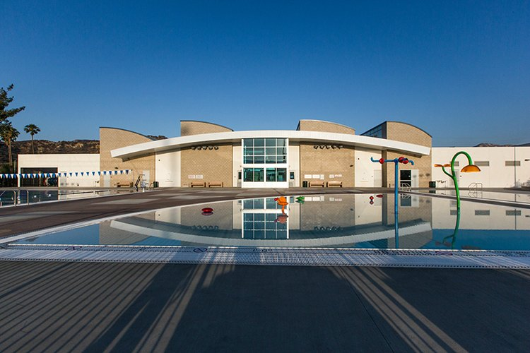 The project consisted of the development of a new pool facility at the Castaic Sports Complex, including, construction of an approximately 8,000 sq. ft. pool building with restrooms, changing rooms, bag room, staff offices, storage and utility rooms, a 25 meter by 25 yard outdoor recreational swimming pool, a 25 yard by 21 foot shallow swimming pool combined with an approximately 2,000 sq. ft. splash pad. Associated site improvements include parking, walkways, fencing, landscaping, grading, and underground utilities. In addition, the project will include off-site road improvements, including asphalt pavement, curb, sidewalk, and lighting along Castaic Road.