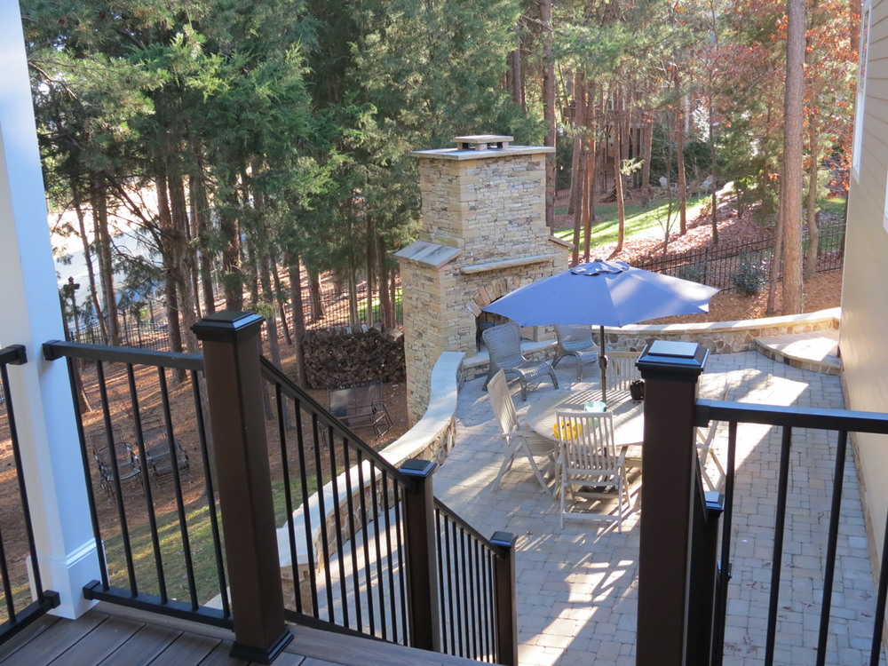 Second story trex deck with stone patio deckscapes for 2 story decks and patios