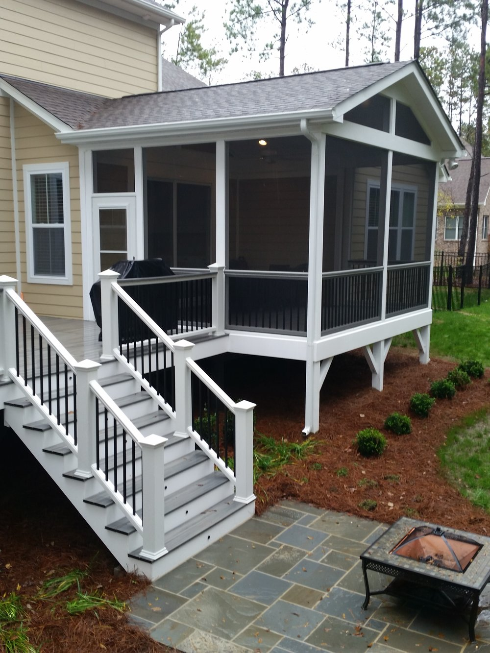 Classic screened porch with trex deck and bluestone patio for Bluestone porch