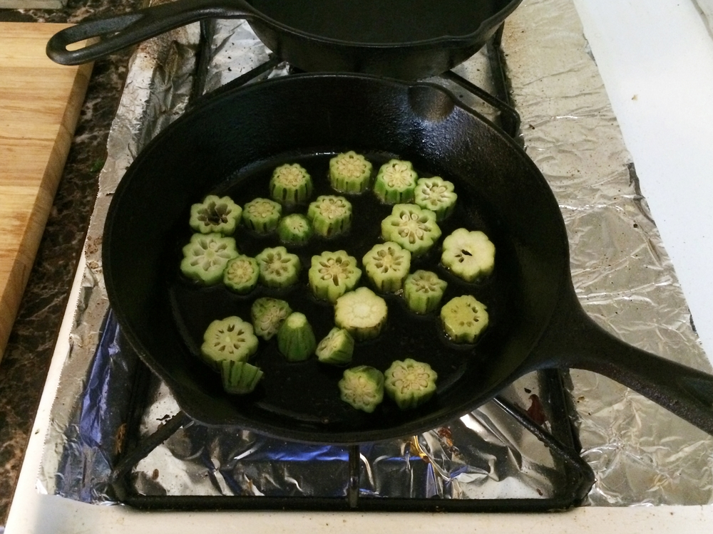 Slice the okra. heat a heavy pan with oil. once the oil is hot, around 320 degrees, add the okra and quickly fry it until golden.