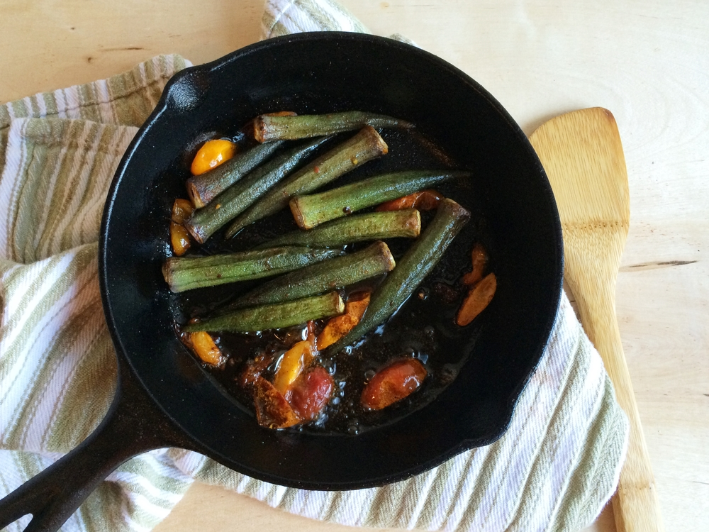I used sliced tomatoes and a little lemon juice for the acid. The red okra turned green while cooking.