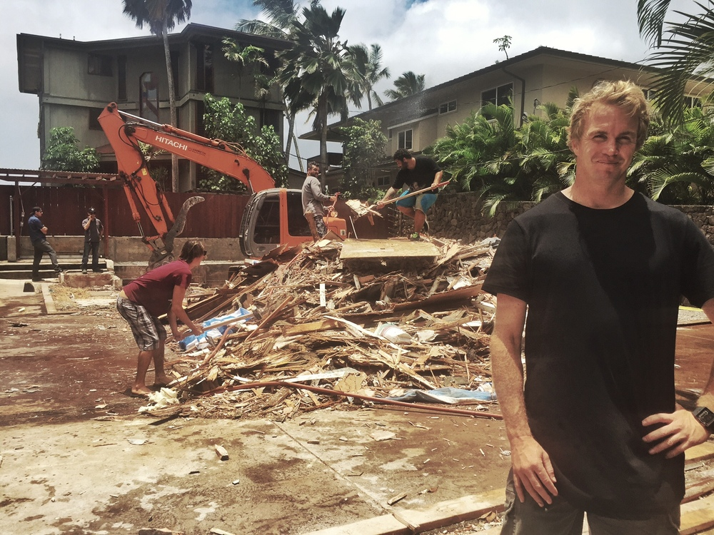 Professional surfer Jamie O'Brien in front of whats left of his iconic North Shore house.