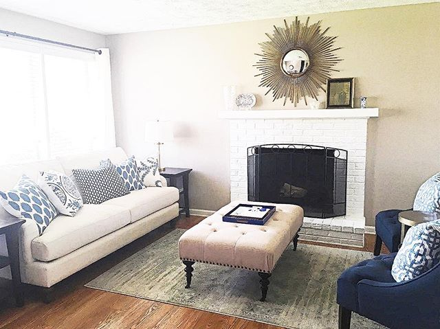 I love when clients send me photos of their completed #edesign spaces! This #blueandwhite living room turned out great. Check out more details on the blog! #blueandwhiteforever #livingroom #coffeetableottoman #starburstmirror #homedecorators #potterybarn #mypotterybarn #overstock #wisteriastyle #rugsusa