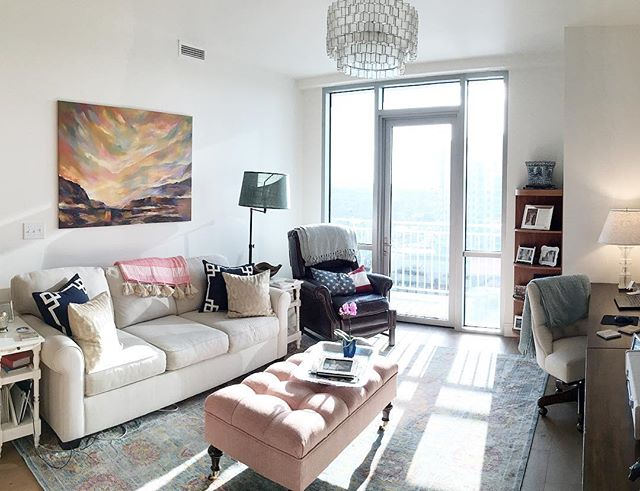 I love when clients send me their #edesign after shots! Check out the blog for more reveal pictures of my recent transitional living room project! #caitlinwilsontextiles  #shareyourcwt #potterybarn #mypotterybarn #overstock #westelm #mywestelm #livingroom #transitional #smallspacedesign #smallspaces #transitionaldesign #chandelier #condoliving #blueandcoral #downtownaustin