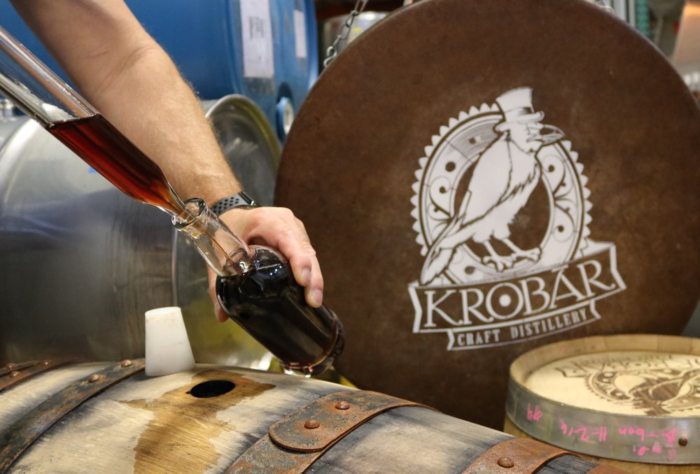 Pulling booze from the barrel.