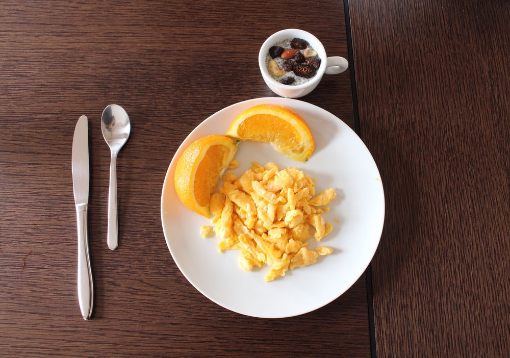 Omelet with fresh, orange-yolk eggs, hand-picked oranges from Douro Valley, and chia seed pudding.