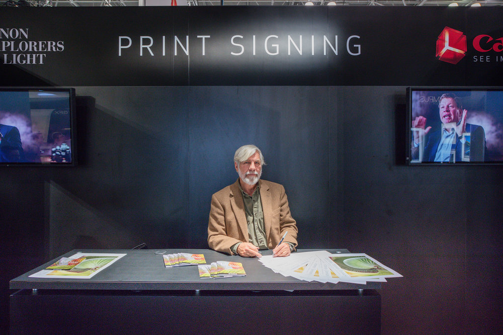Steve in the Canon Booth Signing Posters PhotoPlus. NYC. 2017.