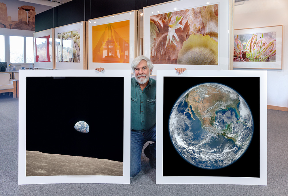 Steve with two new prints for the space exhibit. 2019.