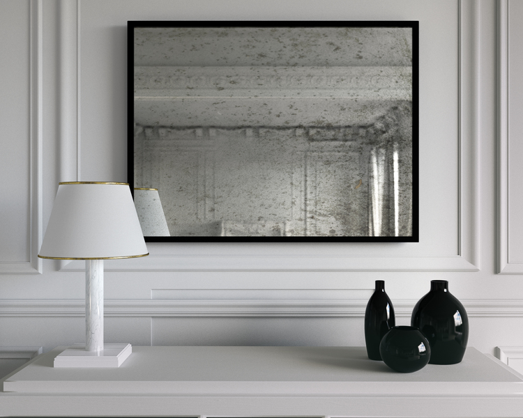 another in situation photograph of hanging wall mirror with black frame