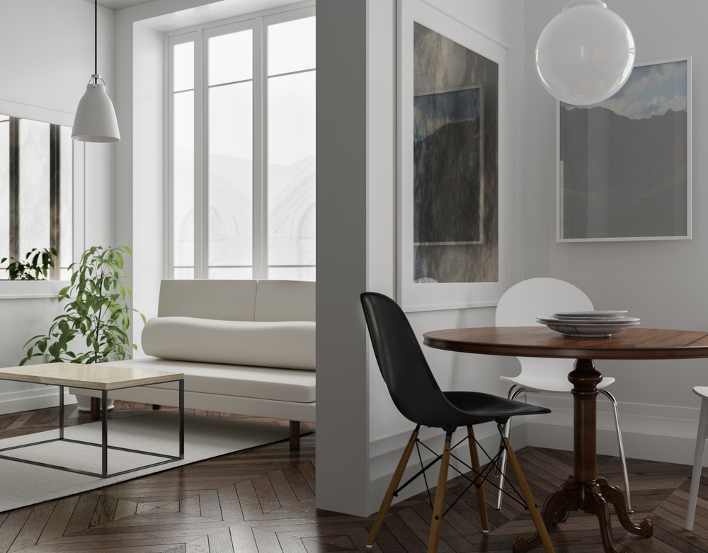 Scandinavian style apartment with two antiqued mirrors, both with white frames.