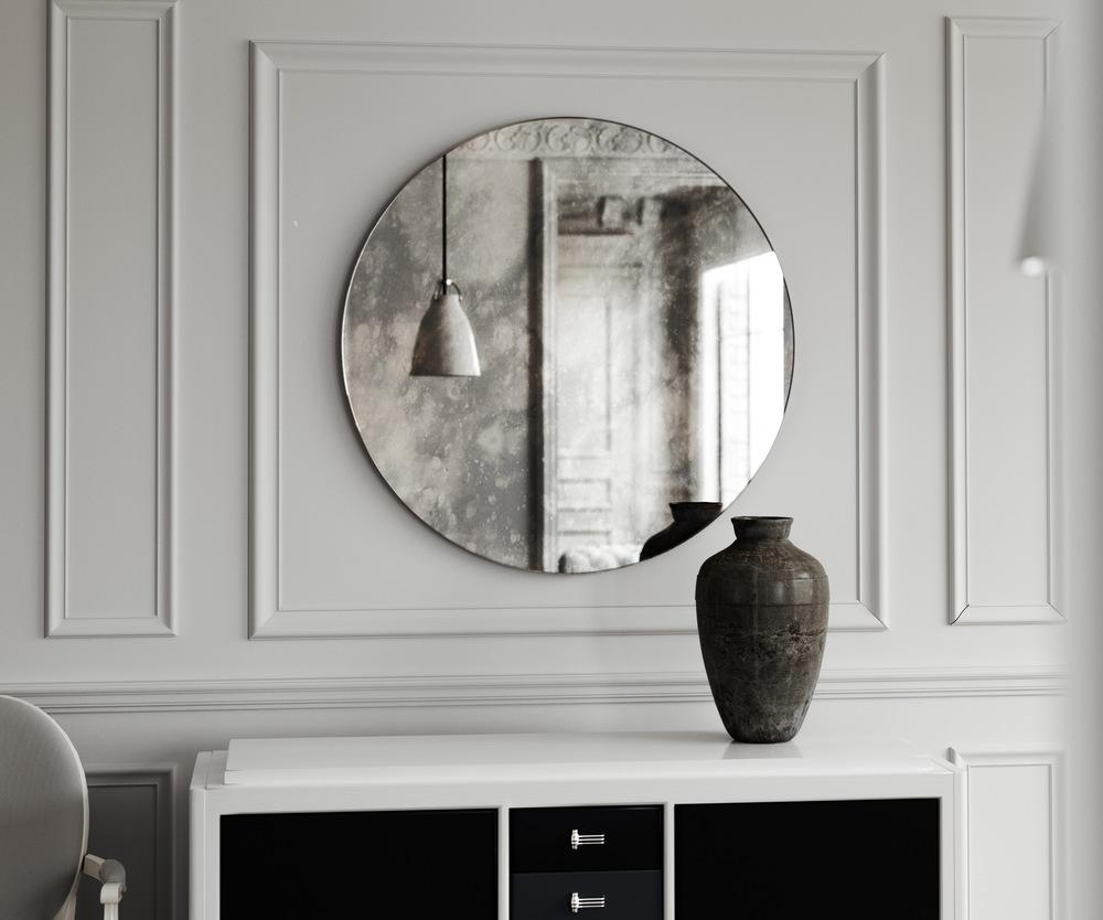 Antiqued mirror with dark pattern.