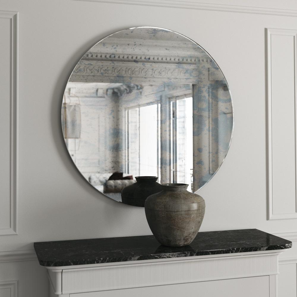 Round frameless blue mirror with interesting blue splattering.