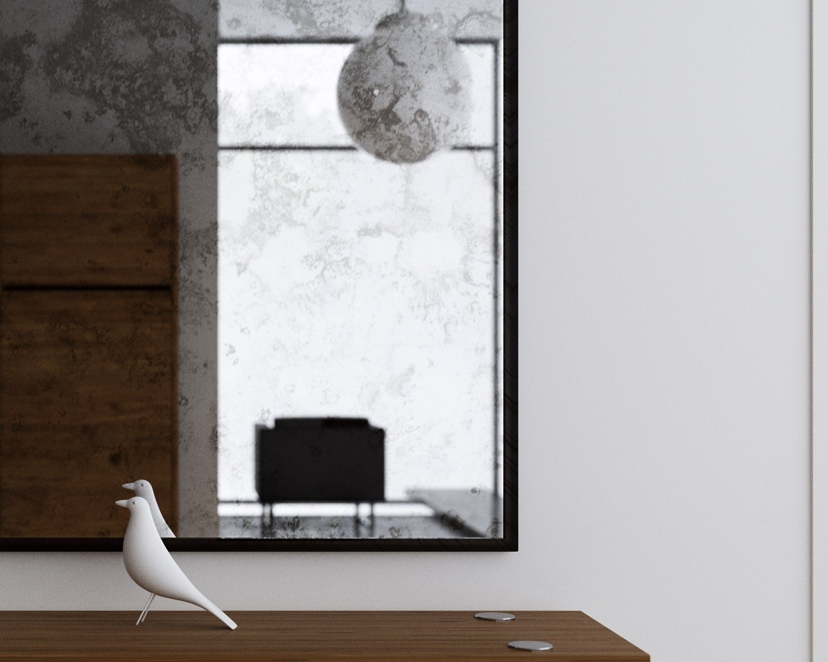 Close up photo of Antiqued Mirror with bird figurine in reflection