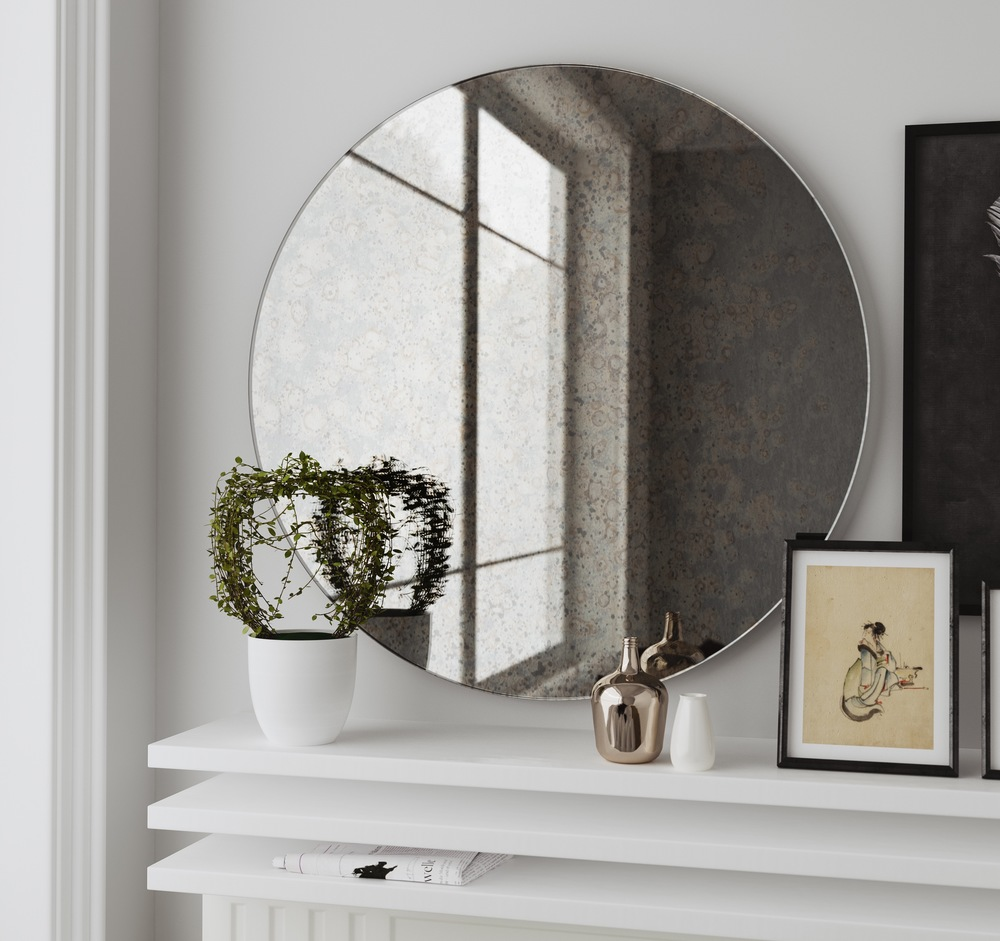 Frameless round wall mirror photographed in California home
