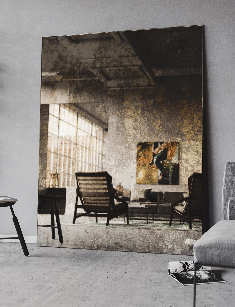 Large mirror photographed in industrial space