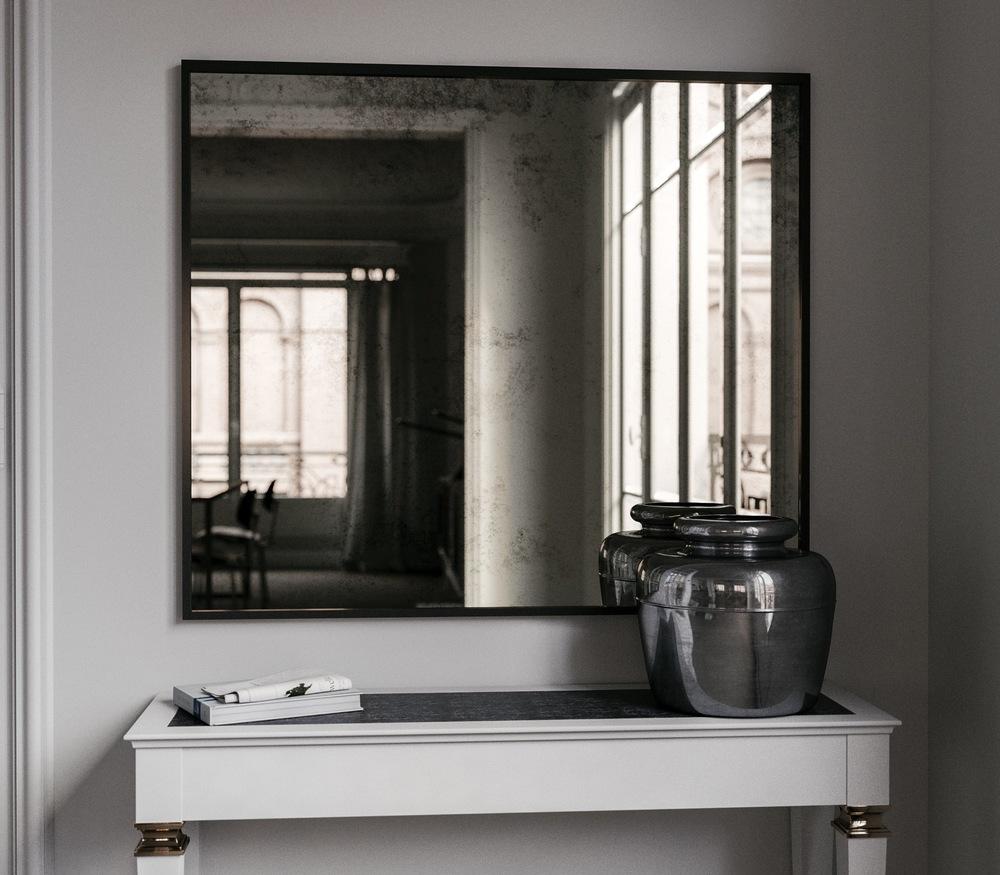 Black framed Antiqued Mirror