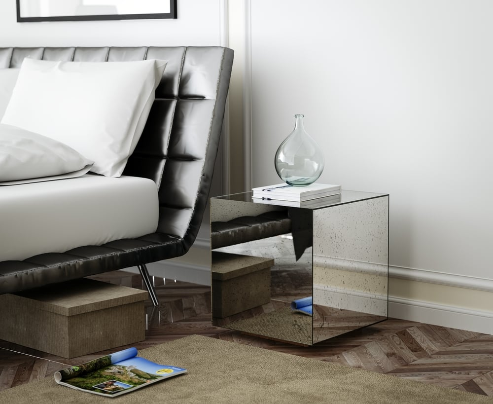 Antiqued Mirrored Sidetable next to Modern Bed