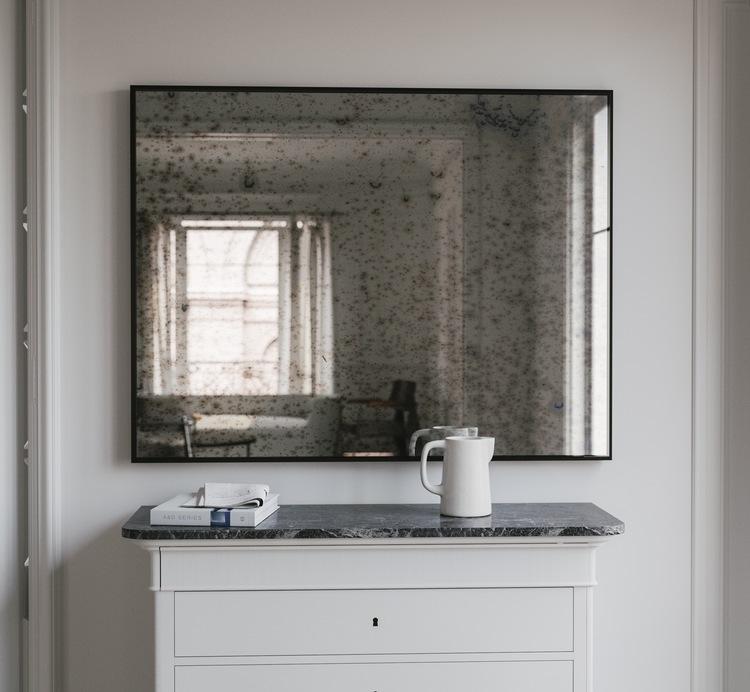 subtle black framed mirror