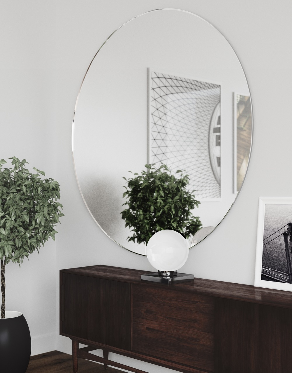 Side photo of Round Wall Mirror by  MirrorCoop.com  hanging in Modern Apartment