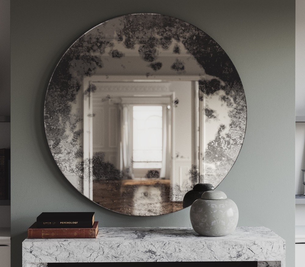 round antiqued wall mirror