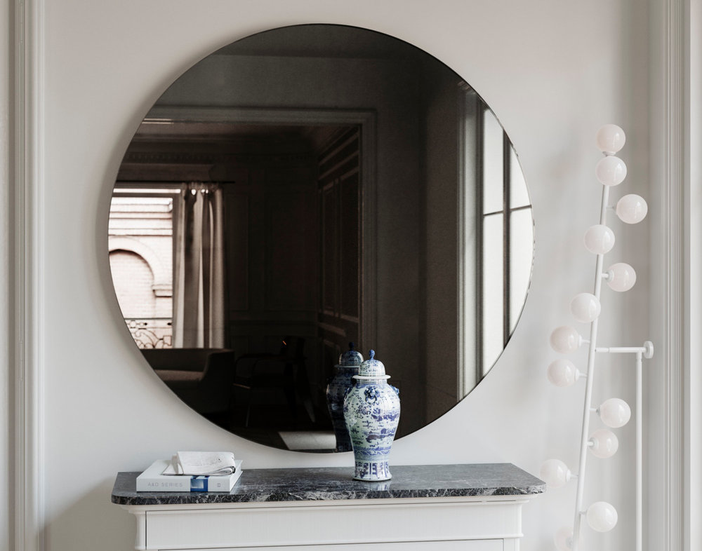 Black wall mirror shown in Situ