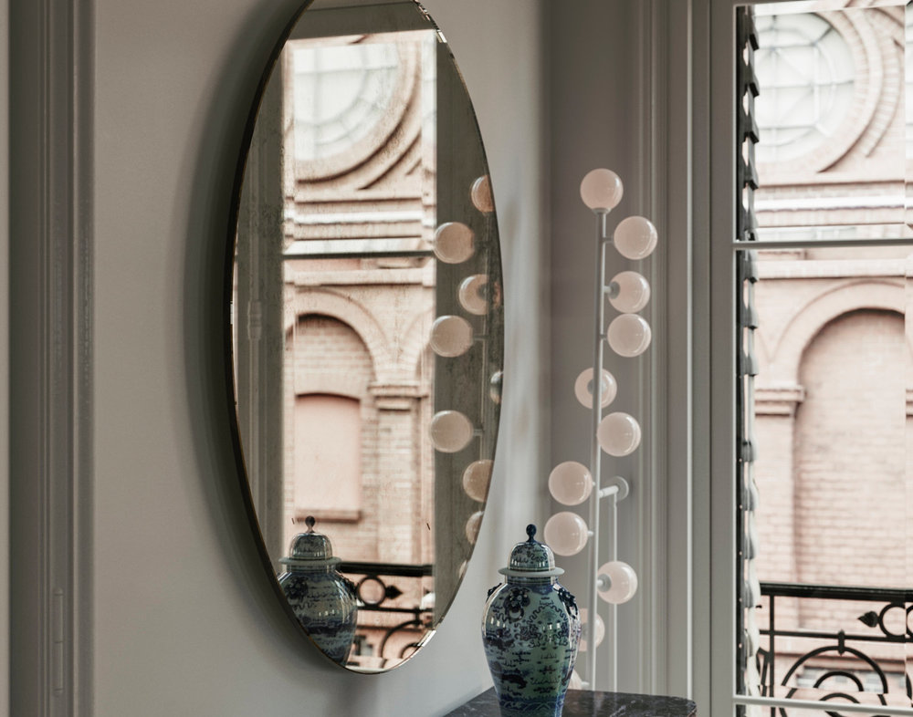 Sideview of Round Mirror hanging in New York residence
