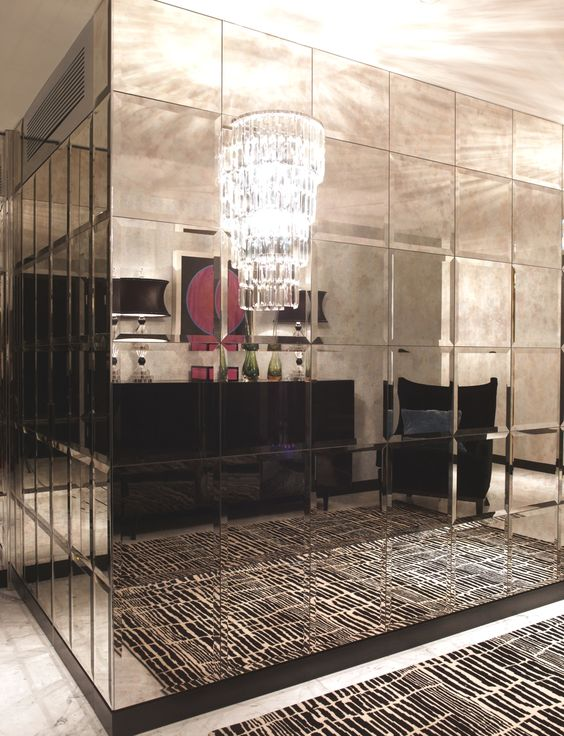 Large mirrors pair well with patterns, producing a receding effect that is sleek and luxurious.