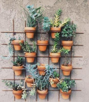 Terracotta pot shelving unit with simple design.