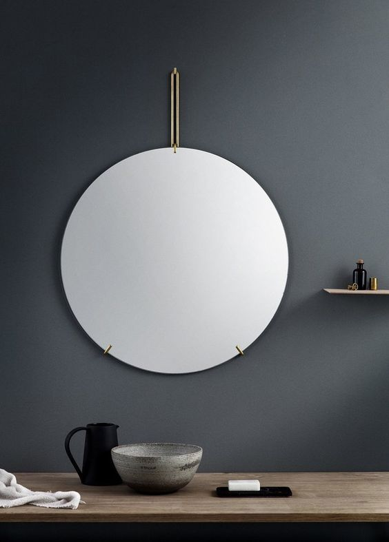 Hanging frameless mirror by chain