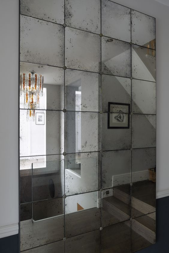 Multiple frameless mirrors with hanging clips and spacers