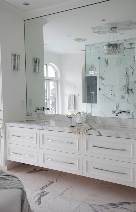 Frameless mirror in bathroom