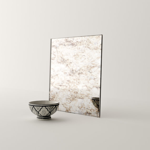 Antiqued Italian mirror. This finish can be made into a large leaning mirror.