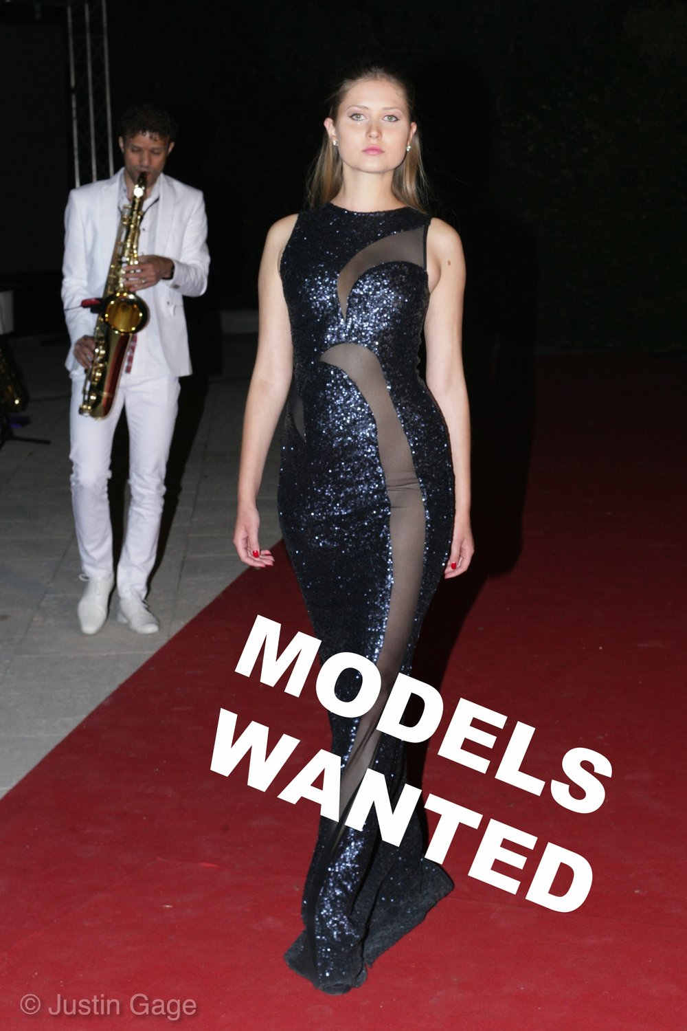 Model in sequin ball gown with a saxophone player behind her