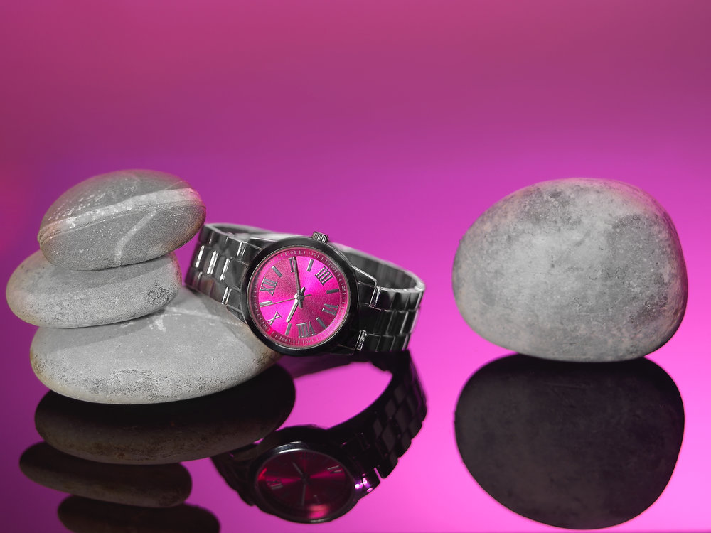 pink faced watch on a reflective surface styles with stones