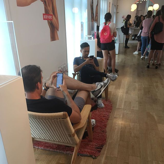Look at all the bored boyfriends at the @glossier showroom.