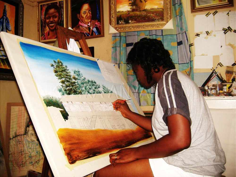 NKOLIKA AT WORK ON HER CANVAS