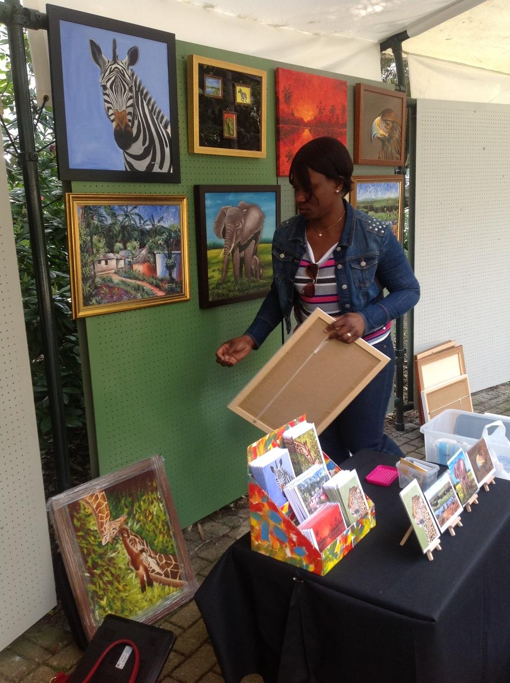 Nkolika Setting up her works