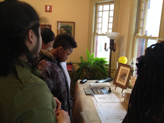 Looking at Lewis H. Latimer's work and drafting tools. Photo by Ran Yan.