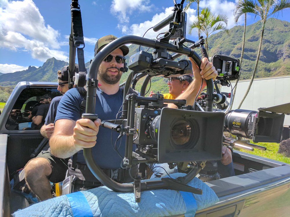 Ryan Hamelin filming car to car in Kualoa Ranch.