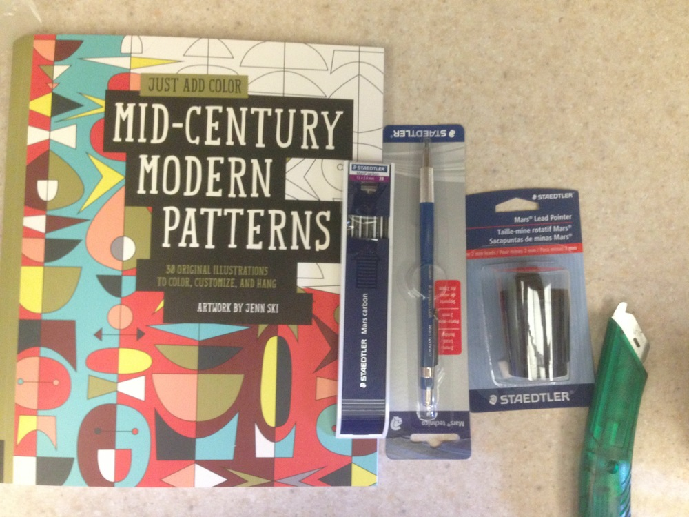 a fun coloring book, and a Staedler lead holder and sharpener for some serious drawing.