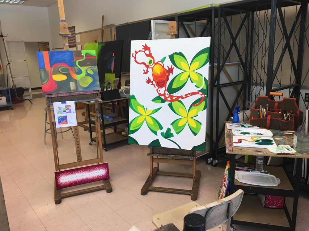 My set up in class. I typically work on 2-3 paintings at the same time. For me, it's a more efficient use of paint. Sometimes you get a great shade mixed on your palette, but more than you need for a particular spot. So I'll use it on another canvas. Paint is too expensive to waste. :)