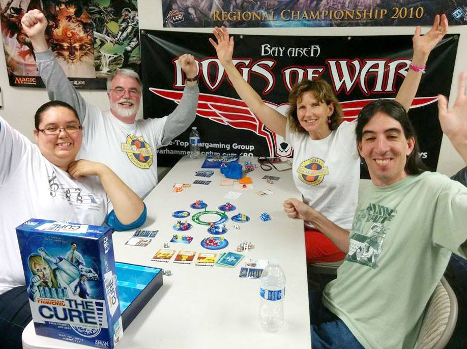 Ken, Jos, and fellow gamers enjoy a victory at the Pandemic Party at Game Kastle in Santa Clara, California