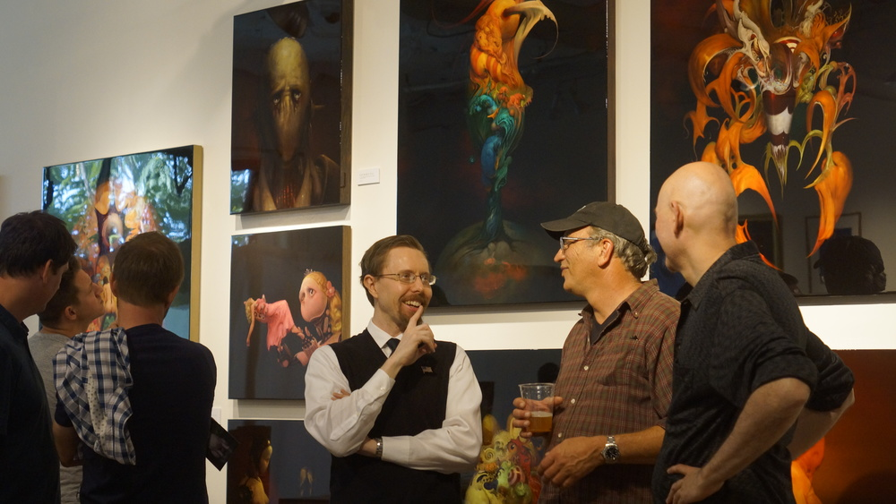Burton Gray talking with a couple visitors about art and the science of creation. BURTON GRAY STUDIO, Brewery Art Walk - Spring 2015