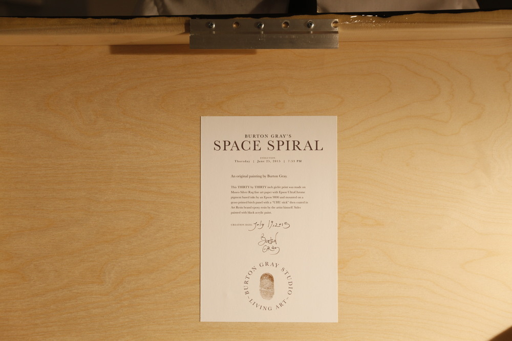 """SPACE SPIRAL,"" Info card on back features artist signature, thumb print and double date. Photo by Lynn Rossi."