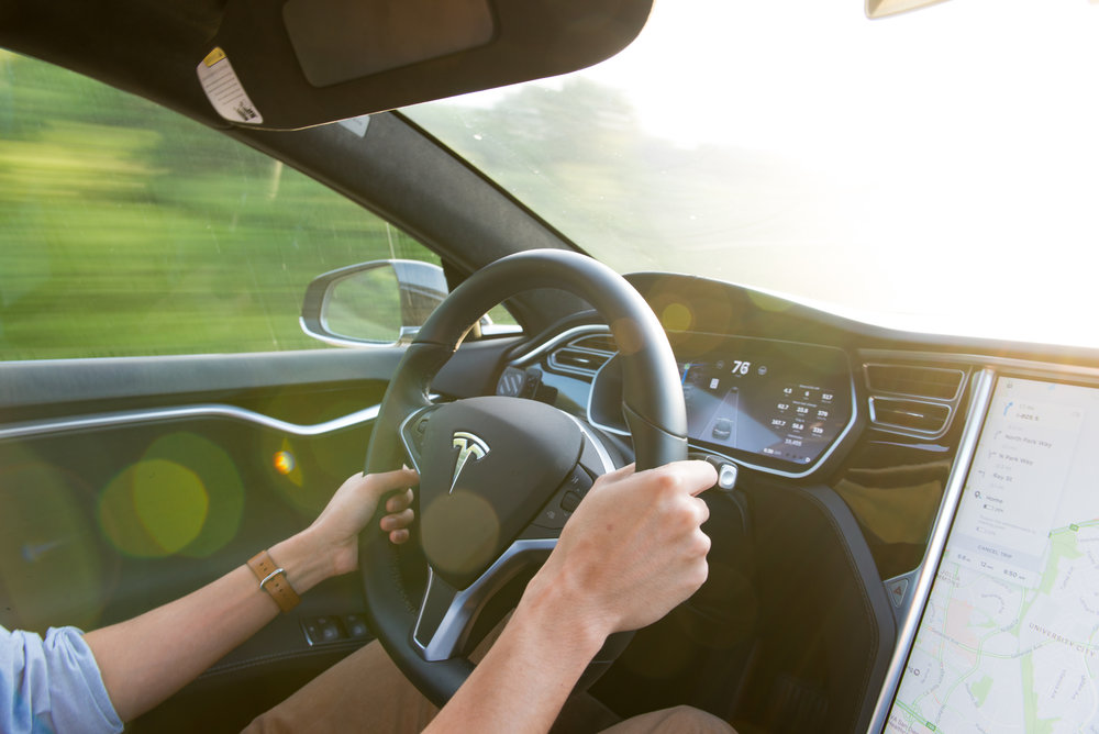 """There are two large displays in the car: one is the driver's cockpit and another the large 17"""" touchscreen that controls almost everything about the car. (cr: @p.uncertainty)"""