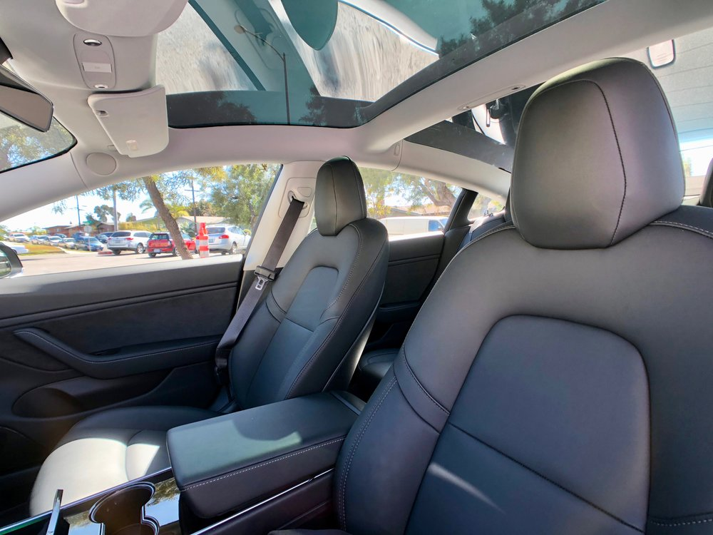 The panoramic glass roof alone is probably worth getting the Premium Upgrade for. It makes the car feel very roomy and also increases the headroom of the rear seat passengers.